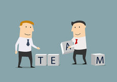 Businessmen creating from cubes the word Team Royalty Free Stock Image