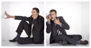 Businessmen in the cube. Spy us spy: businessmen in the cramped white cube royalty free stock photography