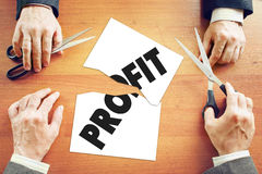 Businessmen cut profit between themselves Royalty Free Stock Image