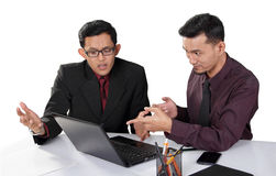 Businessmen debate at their workplace Stock Image