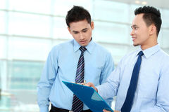 Businessmen discussing Stock Images