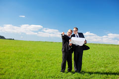 Businessmen discussing a building plan Stock Photography