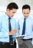 Businessmen discussing a business chart growth Royalty Free Stock Image