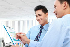 Businessmen discussing a business chart growth. Two businessmen discussing a business chart growth Stock Photo