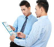 Businessmen discussing a business chart growth Stock Image