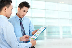 Businessmen discussing a business chart growth Stock Images