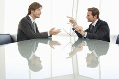 Businessmen Discussing In Conference Room Stock Photography