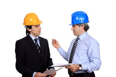 Businessmen discussing a contract stock photo