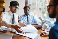 Businessmen discussing contract Stock Images