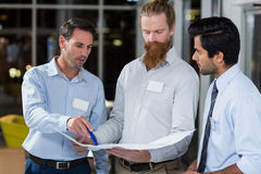 Businessmen discussing over blueprint Royalty Free Stock Photography
