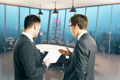Businessmen discussing paper Stock Images