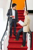 Businessmen Discussing On Steps Stock Image