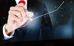 Businessmen draw a graph Stock Photography