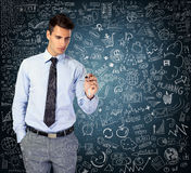 Businessmen drawing business strategy Stock Photography