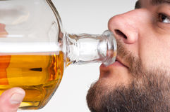 Businessmen drinking from a bottle of whiskey Stock Photography