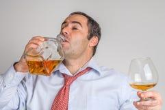 Businessmen drinking whiskey Royalty Free Stock Photo
