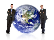 Businessmen with the earth Royalty Free Stock Image