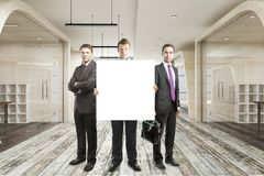 Businessmen with empty banner Royalty Free Stock Photo