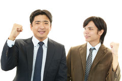 Businessmen enjoying success Stock Images