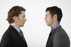 Businessmen Face To Face On White Background Stock Images