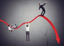 Businessmen falling down. Toward the economic crisis Royalty Free Stock Images