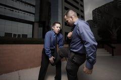 Businessmen fighting Stock Photo
