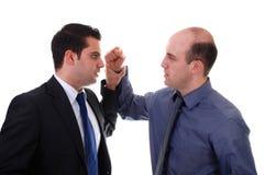 Businessmen fighting stock images