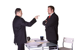 Businessmen Fighting Across the Desk Stock Photography