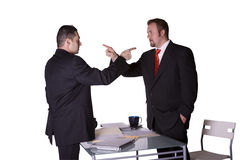 Businessmen Fighting Across the Desk Stock Photos
