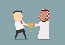 Businessmen fighting over a golden trophy cup Royalty Free Stock Photo