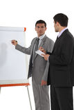 Businessmen with a flipchart Stock Image