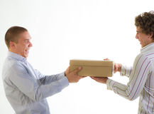 Businessmen and freight. Young businessmen want to deliver quickly freight on a light background Stock Photo