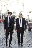 Businessmen friends on road Stock Photo