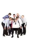 Businessmen in front of a laptop. Group of businessmen in front of a laptop isolated on white background Royalty Free Stock Image