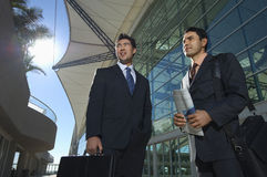 Businessmen In Front Of Office Building Royalty Free Stock Photos