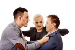 Businessmen getting into a fight woman trying to separate them royalty free stock image