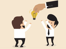 Businessmen is given an idea lightbulb Royalty Free Stock Images