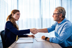 Businessmen giving a handshake Stock Photos