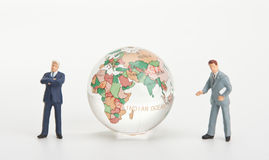 Businessmen and glass globe Royalty Free Stock Photography