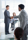 Businessmen greeting each other at a job interview. In an office Stock Photo