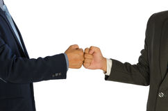 Businessmen greeting with a fist bump isolated Stock Images