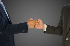 Businessmen greeting with a fist bump  Stock Images
