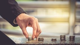 Businessmen are hand-picked collection of medals and coins. The. Concept of financial savings and investments in the business Royalty Free Stock Photos