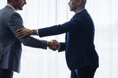 Sophisticated business men shaking hands with each other Stock Photo