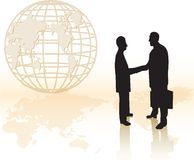 Businessmen Hand Shaking. Two business man hand shaking with a globe in the background Stock Images