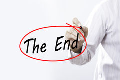 Businessmen Hand writing The End with  marker on visual screen. Stock Image