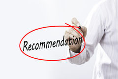 Businessmen Hand writing Recommendation with  marker on visual s Royalty Free Stock Photography