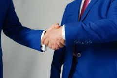 Businessmen hands in formal suits greet each other. Company leaders. Have business meeting and make deal. Partners shake hands for cooperation. Business royalty free stock image