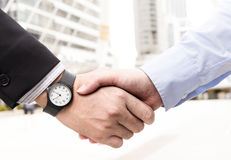 Businessmen are handshake agree to join the business.On a white. Background .Focus at hand Stock Photography