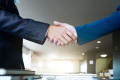 Businessmen handshake dealing, greeting and business partner con Royalty Free Stock Photography